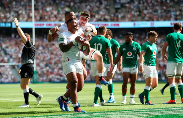 England's Manu Tuilagi (centre) celebrates their third try of the game during the Quilter International match at Twickenham Stadium, London. Photo credit: David Davies/PA Wire.