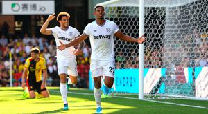 West Ham United's Sebastien Haller (right) celebrates scoring his side's third goal of the game with team mates during the Premier League match at Vicarage Road, Watford. Photo credit: Aaron Chown/PA Wire