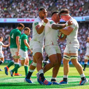 Manu Tuilagi of England celebrates with his team mates Joe Cokanasiga and Tom Curry after scoring his team's third try during the 2019 Quilter International between England and Ireland at Twickenham Stadium on August 24, 2019 in London, England. (Photo by David Ramos/Getty Images)