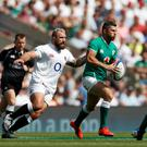 Ireland's Rob Kearney in action against England's Joe Marler at Twickenham. Photo: Reuters/Matthew Childs