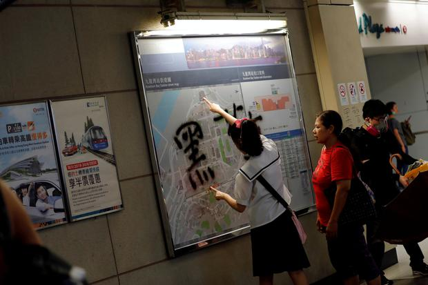 A girl points on a map of a Mass Transit Railway (MTR) route at Kowloon Bay station during a protest in Hong Kong, China, August 24, 2019. REUTERS/Willy Kurniawan