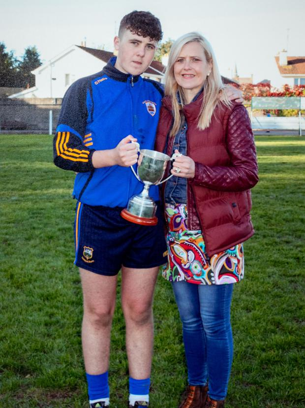 Tragic: Jack Downey with his mother Elaine after the 2018 South Minor A hurling match. Photo: Dylan Vaughan