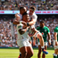 England's Manu Tuilagi (C) celebrates scoring a try with Tom Curry Joe Cokanasiga. Photo: Glyn Kirk/AFP/Getty Images