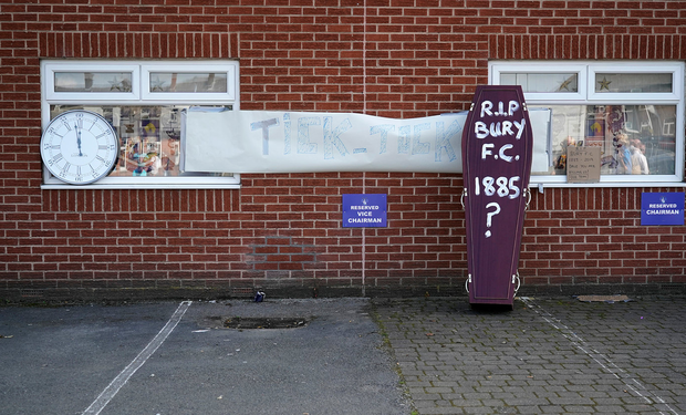 A coffin and a clock outside the Gigg Lane home of troubled Bury FC. Photo: Christopher Furlong/Getty Images