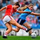25 August 2019; Doireannn OSullivan of Cork has a shot on goal despite the best efforts of Aoife Kane of Dublin during the TG4 All-Ireland Ladies Senior Football Championship Semi-Final match between Dublin and Cork at Croke Park in Dublin. Photo by Brendan Moran/Sportsfile