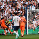 Newcastle United's Brazilian striker Joelinton (L) shoots past Tottenham Hotspur's French goalkeeper Hugo Lloris (R) to score the opening goal of the English Premier League football match at Tottenham Hotspur Stadium in London, on August 25, 2019. (Photo by DANIEL LEAL-OLIVAS/AFP/Getty Images)