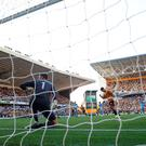 Wolverhampton Wanderers' Raul Jimenez scores their first goal from the penalty spot. Picture: REUTERS/Andrew Yates