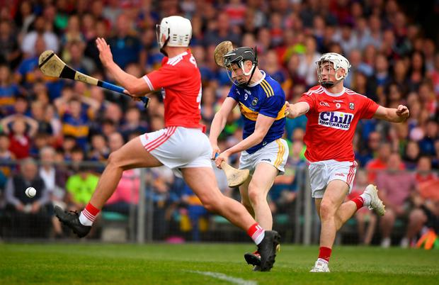 Tipperary's Jerome Cahill in action against Tommy O'Connell, right, and Eoin Roche of Cork. Photo: David Fitzgerald/Sportsfile