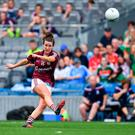 Róisín Leonard kicks the winning free for Galway in their semi-final against Mayo. Photo: Brendan Moran/Sportsfile