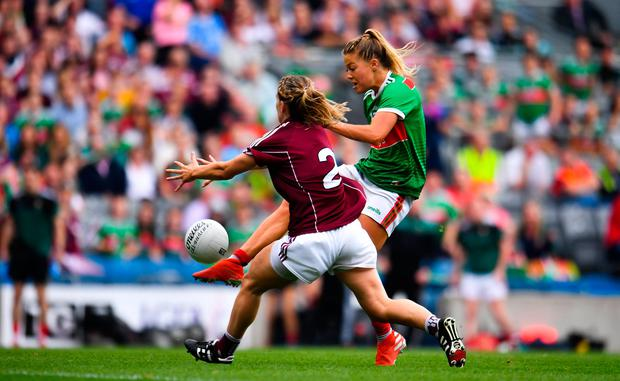 Sarah Rowe of Mayo gets a shot away despite the efforts of Galway's Sinéad Burke. Photo: Sam Barnes/Sportsfile