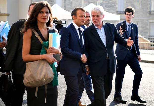 French President Emmanuel Macron walks with the Mayor of Biarritz Michel Veunac ahead of a meeting with Iran's foreign minister Mohammad Javad Zarif during the G7 summit in Biarritz, France, August 25, 2019. REUTERS/Dylan Martinez