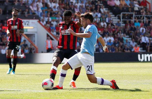David Silva collides with Bournemouth's Jefferson Lerma on his 400th appearance for Manchester City. Photo: Matthew Childs/Reuters
