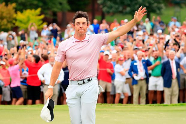 Rory McIlroy celebrates after winning on the 18th green during the final round of the TOUR Championship at East Lake Golf Club, Atlanta, Georgia. Photo: Cliff Hawkins/Getty Images