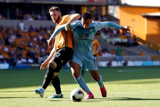 Wolverhampton Wanderers's Matt Doherty (left) and Burnley's Dwight McNeil battle for the ball. Photo: Darren Staples/PA Wire