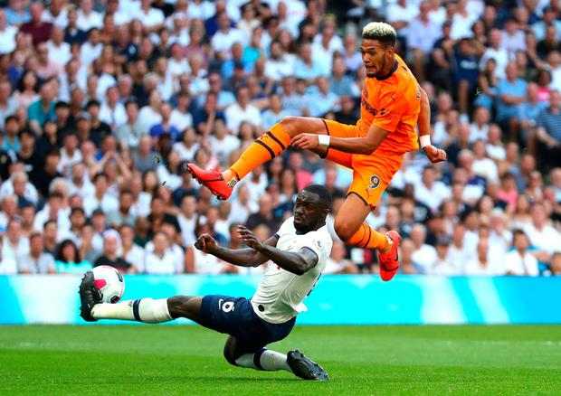 Newcastle's Joelinton is challenged by Tottenham's Davinson Sanchez. Photo: Catherine Ivill/Getty Images
