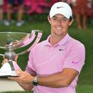Rory McIlroy holds up the FedEx Cup trophy after winning the Tour Championship golf tournament