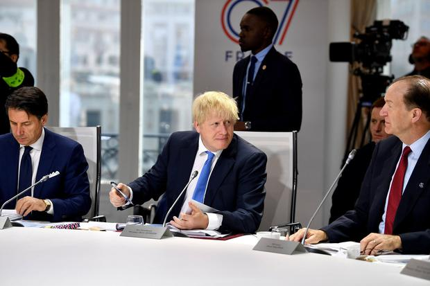 Italian Prime Minister Giuseppe Conte and British Prime Minister Boris Johnson attend the final day of the G7 Summit in Biarritz, France, August 26, 2019. Jeff J Mitchell/Pool via REUTERS