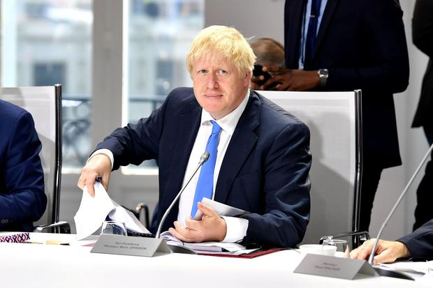 British Prime Minister Boris Johnson attends an extended working session on Climate, Biodiversity and Oceans during the G7 Summit in Biarritz, France, August 26, 2019. Jeff J Mitchell/Pool via REUTERS