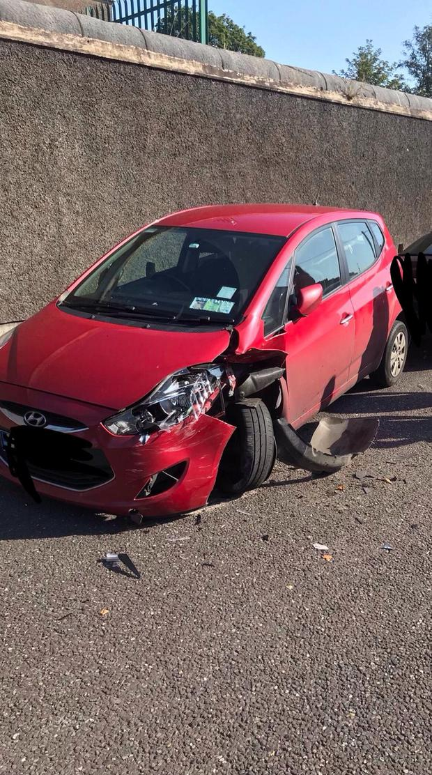 Gardaí believe a passing motorist lost control of their vehicle and rammed two parked cars including the red Hyundai.