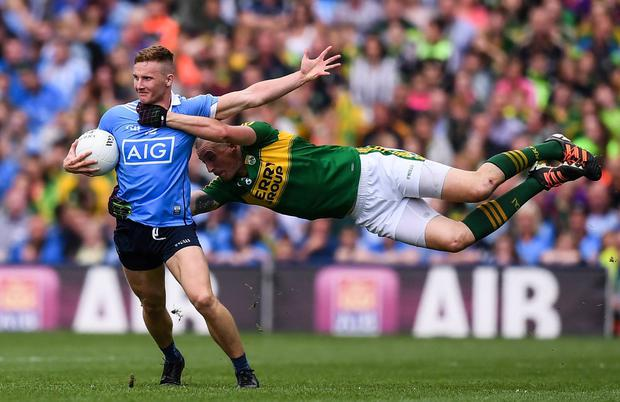 Hanging on: Dublin's Ciaran Kilkenny appeals for a free during a challenge from Kerry's Kieran Donaghy in the thrilling 2016 semi-final. Photo: Stephen McCarthy/Sportsfile