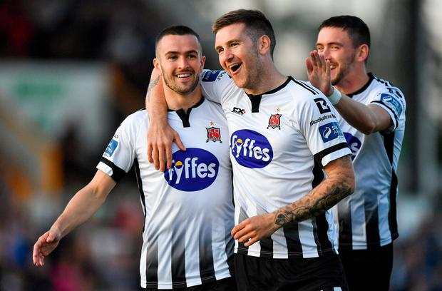 Michael Duffy, left, celebrates with teammates Patrick McEleney, centre, and Dean Jarvis, right, after scoring Dundalk's opener. Photo: Seb Daly/Sportsfile