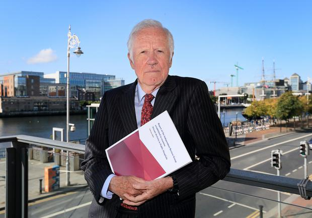 Optimistic: Dr Donal de Buitléir with a copy of his report at the launch in Dublin. Photo: Frank McGrath