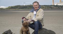 Gerry Grennell with his dog Millie taking a walk at Sandymount in Dublin. Photo: Arthur Carron