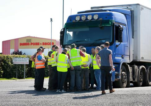 Road block: Farmers and managers from Dawn Meats, Grannagh in Co Waterford, try to negotiate. PHOTOS: Frank McGrath
