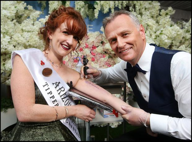 Arizona Rose Kayla Gary gets Dáithí O'Sé to give her a tattoo at the Rose of Tralee International Festival. Pic Steve Humphreys 26th August 2019.