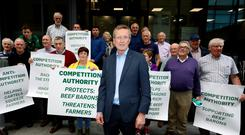 Tim Cullinan, flanked by farmers, handing in a letter to the Competition and Consumer Protection Commission calling for an investigation into the beef industry.