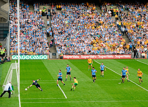 Ryan McHugh fires home Donegal's second goal past Stephen Cluxton in the 2014 All-Ireland semi-final as Dublin defenders (from left) Mick Fitzsimons, Rory O'Carroll, Cian O'Sullivan and Philly McMahon look on. Photo: Stephen McCarthy / Sportsfile