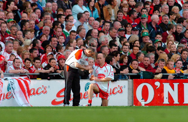 Mickey Harte chatting with Peter Canavan before his return to the pitch. Photo: Sportsfile