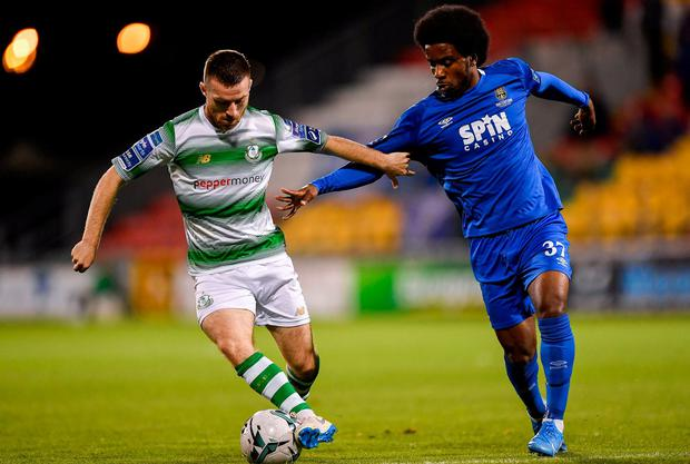 Jack Byrne of Shamrock Rovers in action against Walter Figueira of Waterford. Photo: Seb Daly/Sportsfile