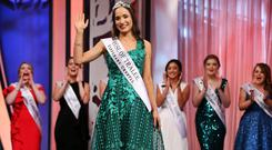 Limerick Rose Sinead Flanagan, who was crowned the winner of the 2019 Rose of Tralee competition, salutes the crowd at the Dome in Tralee last night. Photo: Steve Humphreys