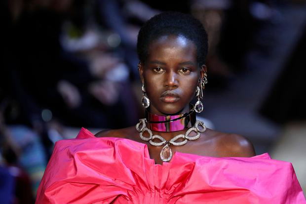 Australian-Sudanese model Adut Akech presents a creation by Alexander McQueen during the Women's Fall-Winter 2019/2020 Ready-to-Wear collection fashion show in Paris, on March 4, 2019. (Photo by FRANCOIS GUILLOT / AFP)