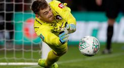 Bournemouth's Mark Travers saves a penalty during the penalty shootout in the Carabao Cup second round win over Forest Green Rovers at the Vitality Stadium, Bournemouth. Photo: Reuters/Paul Childs