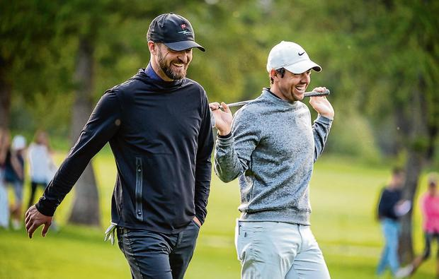 Perfectly in sync: Rory McIlroy walks with the fairways with singer-songwriter Justin Timberlake during a pro-am event ahead of the Omega European Masters in Switzerland yesterday. Photo: Fabrice Coffrini/AFP/Getty Images