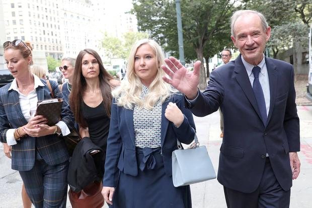 Legal battle: Lawyer David Boies arrives with his client Virginia Giuffre for a hearing in the case against Jeffrey Epstein. Photo: Shannon Stapleton/Reuters