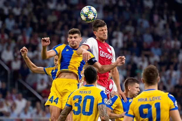 Ajax Amsterdam's Dutch forward Klaas-Jan Huntelaar (r) fights for the ball with APOEL's defender Nicolas Ioannou during the Champions League play-off second leg at the Johan Cruyff Arena in Amsterdam