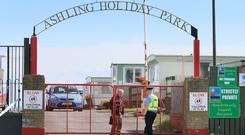 A garda outside the Ashling Holiday Park in Clogherhead, Co Louth, where a man was fatally shot. Photo: Frank McGrath