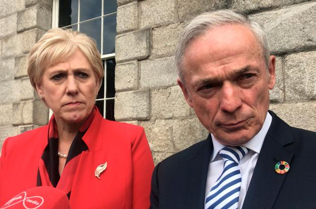 Minister for Business Heather Humphreys and Communications Minister Richard Bruton speaking outside Dublin Castle on Thursday. Photo: Cate McCurry/PA Wire