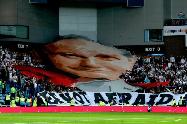 Legia Warsaw fans unveil a banner of Pope John Paul II and one that reads 'Be Not Afraid' during the Europa League match at Ibrox Stadium, Glasgow. Photo: Jane Barlow/PA Wire