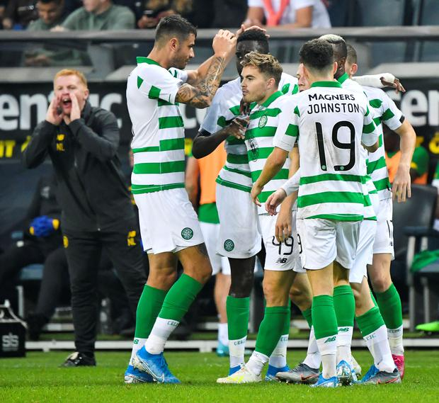 James Forrest of Celtic celebrates opening the scoring with team-mates in the Europa League play-off win over AIK