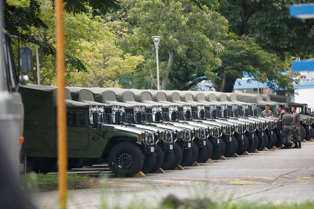Presence: Troops by a row of army vehicles at the Shek Kong military base of People's Liberation Army in New Territories, Hong Kong. Photo: Reuters