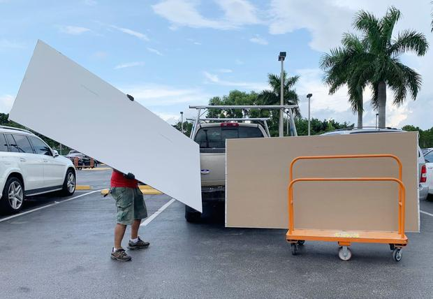 Shoppers prepare ahead of Hurricane Dorian at The Home Depot on Thursday, Aug. 29, 2019, in Pembroke Pines, Fla. (AP Photo/Brynn Anderson)