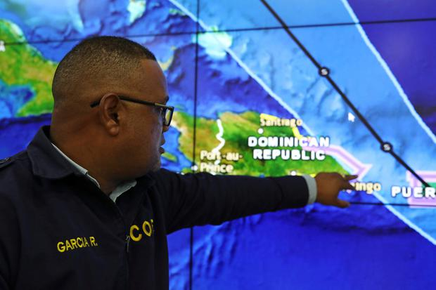 A member of the Emergency Operations Committee (COE) monitors the trajectory of Storm Dorian in Santo Domingo, Dominican Republic August 27, 2019. REUTERS/Ricardo Rojas