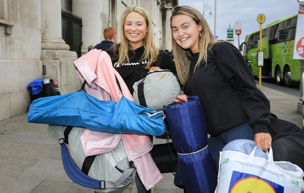 Electric Picnic festival revellers depart Dublin for Stradbally. Kate Stanley and Aine Osbourne prepare to board the bus for the Co. Laois venue. Picture; Gerry Mooney