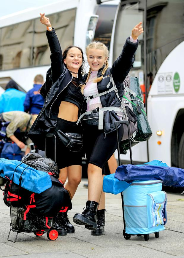 Electric Picnic festival revellers depart Dublin for Stradbally. Corina Kelly (19) and Jess Treacy (20) prepare to board the bus for the Co. Laois venue. Picture; Gerry Mooney