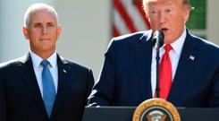 Visit: US Vice-President Mike Pence (left) is to visit Europe in place of Donald Trump. Photo: SAUL LOEB/AFP/Getty Images