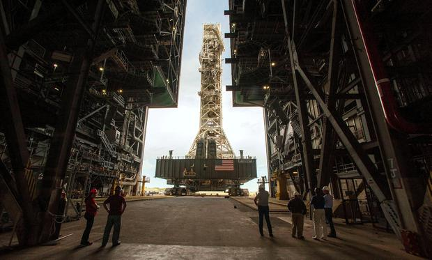 NASA employees look on as the Artemis launch tower rolls back from Pad 39B inside Bay 3 of the Vehicle Assembly Building (VAB) at the Kennedy Space Center in preparation for the landfall of Hurricane Dorian, in Cape Canaveral, Florida, U.S., August 30, 2019. REUTERS/Steve Nesius